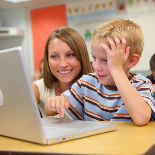 Student-and-teacher-with-laptop-Feature-Image